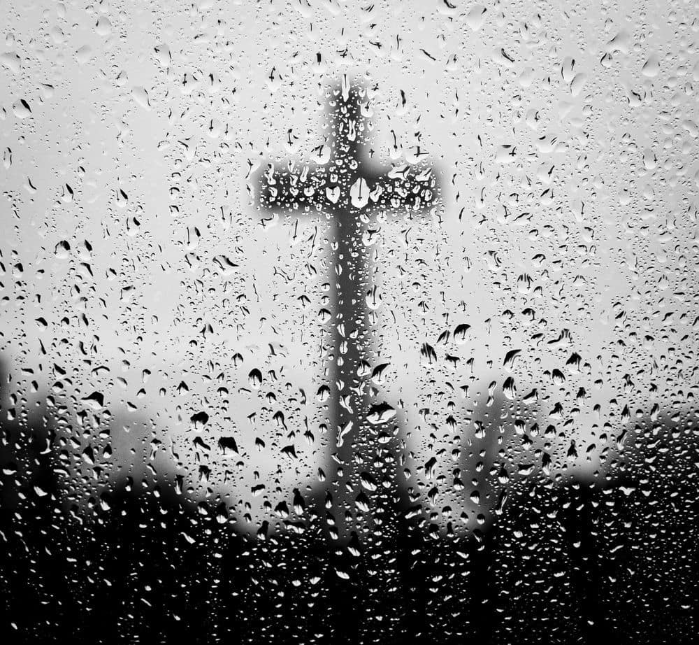 cross in rain