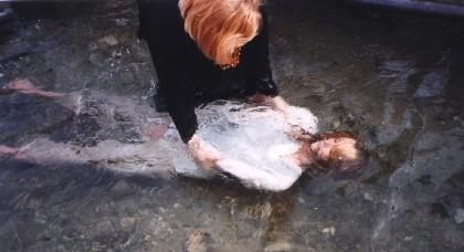 femeia să boteze
