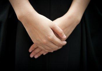 hands_crossed_on_black